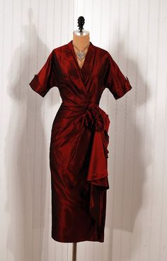 This dramatic vintage cocktail dress is absolutely gorgeous!