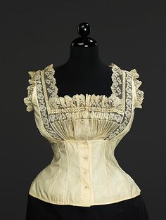 "Corset Cover: 1889, American or European, cotton. Marking: Woven label with script: ""M"""