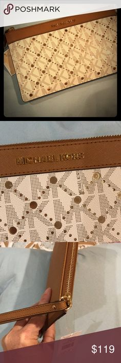 New with tags Michael Kors clutch New with tags Michael Kors clutch. MICHAEL Michael Kors Bags Clutches & Wristlets