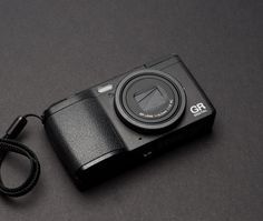 Is This the Perfect Compact Camera for Street Photography? Here's what the Ricoh GR Digital IV looks like in its fully relaxed state. Made Goods, Leica, Mp3 Player, Street Photography, Compact, Digital, Gadget, Gears, Black