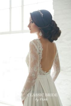 loose updo wedding hairdo and open back long sleeves wedding dress