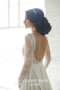 loose updo wedding hairdo and open back long sleeves wedding dress