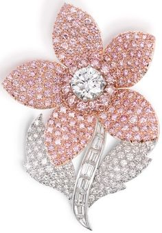 Graff pink and white diamond flower brooch featuring 177 pink diamonds totalling 9.64ct (total diamond weight 18.14ct).      Via The Jewellery Editor.