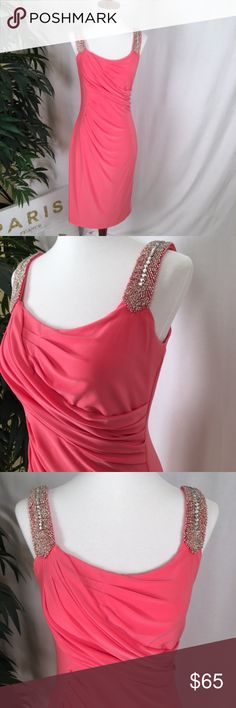 """Ralph Lauren Cocktail Dress This fabulous, coral colored Ralph Lauren dress is in EXCELLENT used condition & makes a beautiful entrance! The silver rhinestone & beaded straps (in perfect shape) lend just the right amount of bling. I wore this once to a wedding paired with a sexy, silver shoe. Comfortable to wear, easy to dance in, and fully lined. No zipper, pull-over style. Measures: 33"""" down front; 18"""" pit to pit; 31"""" down back. Tags/extra beading included. NO Smoking/NO Pets Ralph Lauren…"""