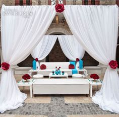 Loving the blue and red color combination of this cocktail lounge area for guests