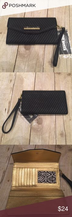 Steve Madden NWT black wallet with strap Just in Steve Madden NWT black wallet with strap. Gold interior 7 3/4x 4.5 Steve Madden Bags Clutches & Wristlets