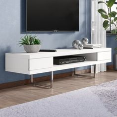 Wade Logan Busey TV Stand for TVs up to Color: White Lacquer Living Room Tv, Living Room Furniture, Home Tv Stand, Floating Entertainment Center, Entertainment Centers, Floating Tv Stand, Metal Wall Panel, Solid Wood Tv Stand, White Laminate