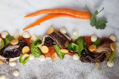 """Alma No. 2."" Variations of seasonal vegetables and fruits -- including roasted radicchio and corn powder, semi-dehydrated heirloom tomatoes, sweet and spicy baby carrots, dehydrated cauliflower, marinated Brussels sprouts, nectarines and apricot jelly."