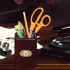 NFL Pittsburgh Steelers Wooden Logo Pencil Cup  https://allstarsportsfan.com/product/nfl-pittsburgh-steelers-wooden-logo-pencil-cup/  NFL® team pencil holder Crafted with fine walnut finish Accented with a stunning antique brass medallion team logoSize: H 4.25 in x W 3.375 in