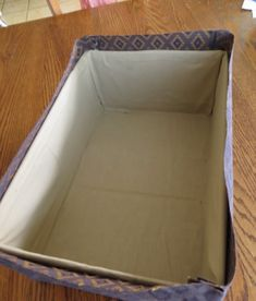 I talked to one of my aunts a while back and told her I would post a tutorial on how to wrap a box in fabric. Cardboard Organizer, Cardboard Box Crafts, Cardboard Furniture, Fabric Storage Boxes, Fabric Boxes, Diy Home Crafts, Creative Crafts, Fabric Covered Boxes, Fabric Basket Tutorial