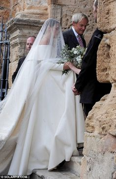 The Duke of Wellington's daughter Lady Charlotte Wellesley arrived for her wedding in Granada beaming. The wedding, which was held on Saturday in Granada, Spain, saw her marry financier Alejandro Santo Domingo.