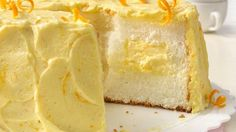 Transform boxed angel food cake mix into a mouthwatering masterpiece with creamy orange filling and frosting.