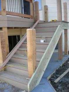 After the patio is complete the work on the deck stairway begins. The materials for the stairway are the same as those used to construct the deck. The material for the treads and risers is TimberTe… Treads And Risers, Stair Treads, Patio Stairs, Building Stairs, House Trim, Back Deck, Deck With Pergola, Composite Decking, Deck Design