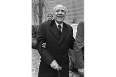 """This file photo taken on January 17, 1983 shows Argentine writer Jose Luis Borges arriving at the Political and Moral Sciences Academy in Paris for a reception. During a conference on September 7, 2016 at the Casa de America in Madrid, Argentinian Marcos Ricardo Barnatan, biographer,friend and countryman of Jorge Luis Borges, explained the impact of the Jewish Kabbala on Borges' stories like """"The Zahir"""", """"The writing of the god"""" or """"Death and the compass"""". STR / AFP."""