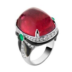 Bulgari Ring. High Jewelry Ring set in 18kt white gold ring with a pink tourmaline, emeralds and diamonds