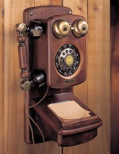 "Old fashioned wooden wall telephone--I remember these-- they were a ""party line"" & all the neighbors could hear your conversation! Hard to even imagine now!"