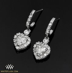 Platinum Diamond Heart Earrings Set With Two Cut Diamonds And Adorned Whiteflash A Above Melee