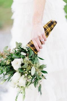 Add a little #plaid for a #winter wedding! Caroline Lima Photography | See More on SMP:  http://www.StyleMePretty.com/2014/01/02/rustic-winter-wedding-inspiration/