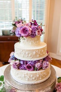 Spring wedding cake idea - three-tier wedding cake with purple + pink floral layers and elegant frosting details {The Collection}