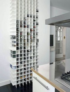 very cool wine storage- clean, simple, angular and un-intimidating. would fit well in many homes!