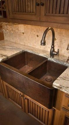 Copper Farmhouse Sink. Love the double compartment sink and those style under cabinets