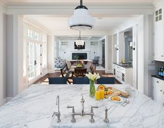 Lake House With a Classic Coastal Feel - The Dining Room opens directly to the Kitchen.
