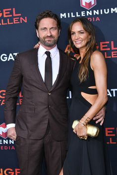 """Gerard Butler Photos - (L-R) Gerard Butler and Morgan Brown attend the LA Premiere of Lionsgate's """"Angel Has Fallen"""" at Regency Village Theatre on August 2019 in Westwood, California. - LA Premiere Of Lionsgate's """"Angel Has Fallen"""" - Arrivals Gerard Butler Morgan Brown, Windsor, Daryl Sabara, London Has Fallen, Paisley Scotland, Poster Boys, Just Jared Jr, Meghan Trainor, Smiles And Laughs"""