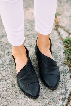 Black flats. Original design, made of leather. White trousers for winter.