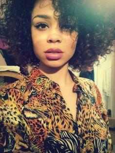 Smokey eye and pale lips.... and curls