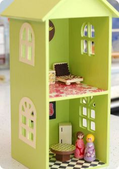 10. This simpler dollhouse is made from a CD shelf. | 39 Coolest Kids Toys You Can Make Yourself