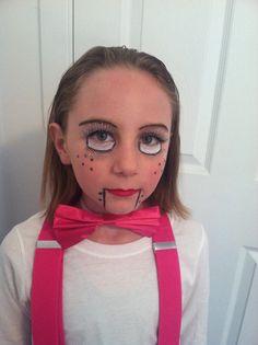 Easy Ventriloquist Dummy Halloween costume makeup for kids:  Fake eyelashes, white cream makeup, black eyeliner, red lipstick