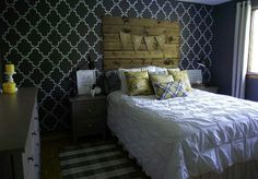 ●Get-Noticed Walls - Even if you don't want go bold all over, create an eye-catching accent wall. We love the graphic black and white trellis print stenciled on the wall behind the bed over at AKA Design. The rustic wooden headboard and pretty pillows complete the look.