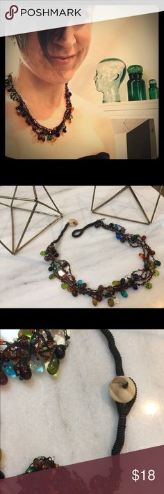 Boho glass bead necklace Love it, just don't wear it. I bought this on my travels to the Middle East. Beautiful, multicolored, handmade necklace. Condition is how I bought it, good handmade condition, with rustic bohemian look. Jewelry Necklaces