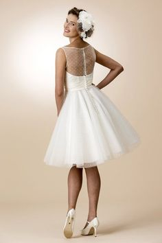 1950's tea length wedding dress from Brighton Belle by True Bride. Love the polka dots!