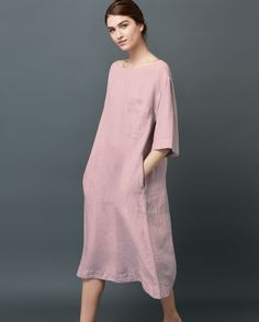 Loosely fitting, loungey dress in a supple and weighty garment-dyed linen. A-line and swingy through the body with horizontal seam detail towards hem. Wide, boat-ish neck. Breast patch pocket. Gently curving hem.