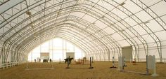 Equine Riding Arena- My friend Sara has a barn and arena made out of this and I love the natural light it has!