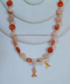 CRPS/RSD Orange Botswana Necklace --puffy coin item# OBNPC  Price: $41.00