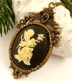 Elegant necklace with cameo elf in black bronze~ This enchanting necklace is a beautiful gift idea for all fans of fantasy and fairy tales. It consists of a solid metal frame crafted in bronze and a beautiful cameo in black creme with elf on a flower. The setting is also adorned with black Swarovski rhinestones.