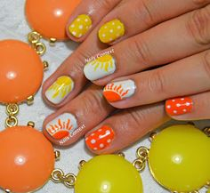 Summer Sun! Hello! It's Summer. It's HOT. It's 98F outside with blazing sun. So I decided to do a Summer Sun nail art this past Sunday. I drew the sun freehand using a very fine nail art brush. The polishes that I used are Zoya's Darcy, Cotton Buds and Silly Billy from Butter London. I have done a similar sunburst nail design earlier this year and you it here. #prom #yellow #orange
