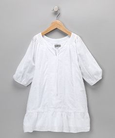 Fresh like a bouquet of flowers, this dress has a Swiss dot pattern that's perfect for any affair. Delicate details like a ruffled hem and a tie neckline make it the friendly frock for little ladies everywhere.100% cottonMachine wash; hang dryMade in Vietnam