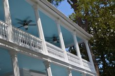 """#Haint Blue is the pale blue color you will often see on the porch ceilings in historic Beaufort. """"Haint"""" is the Gullah pronunciation for """"haunt,"""" or spirit. Spirits could not cross water. Tricked by the pale blue ceilings or painted window frames, these angry spirits fear the """"water"""" and avoid the house. This method of driving evil away was told and retold by the Africans from Angola when they were brought here as slaves to the sea islands to grow rice and indigo in the 1700's."""