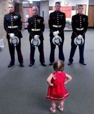 Which One of You Marines Ate My Ice Cream? Marines are tough, but nothing says tough like a little girl in red with pigtails and her hands in fists at her hips.