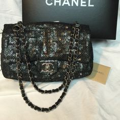 Authentic Chanel Classic Sequin handbag Authentic Chanel classic medium size flap handbag. Silver hardware. Sequin mesh fabric. Gorgeous rare Chanel! Comes with box and care booklet. Hologram intact. Good condition. Thanks for looking. CHANEL Bags