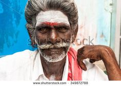 Rameswaram City,Tamil Nadu, South India. November 2010  An unidentified Indian man on the street. The red dot and white broad band on the forehead man - a symbol of the worship of the Indian god Shiva