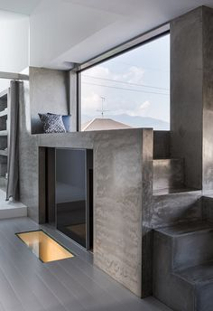 This Japanese residence features an assortment of finishes, including polished concrete and ceramic tiles.