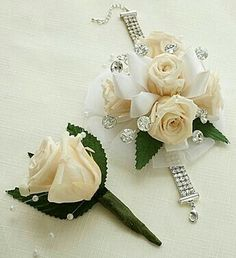 Infinite Rose Antique White Corsage & Boutonniere Add a touch of turquoise and pink to match the dress Red Corsages, White Corsage, Prom Corsage And Boutonniere, Flower Corsage, Corsage Wedding, Wedding Bouquets, Boutonnieres, Homecoming Flowers, Prom Flowers