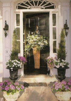 Flowers on the front door! Mary Carol Garrity's Front Door with Spring Basket of Daisies Front Door Planters, Front Door Porch, Front Door Entrance, Front Entrances, Front Door Decor, Wreaths For Front Door, Door Wreaths, Tall Planters, Doorway