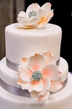 1950s Wedding Ideas | Confetti Daydreams - Flawless white fondant wedding cake with pale peach sugar flowers and gray ribbon