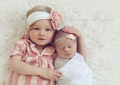 coordinating hairbands for all the girls & very neutral shades, like the swaddling idea. maybe put the kids in a circle so all  heads are touching