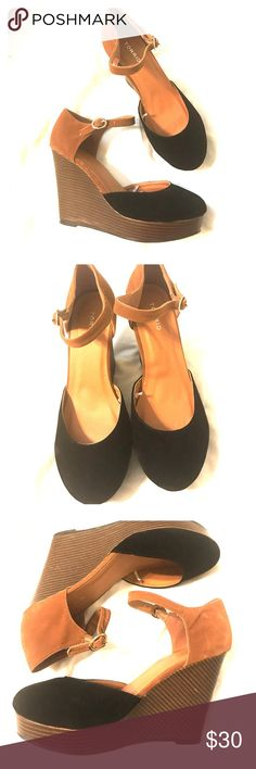 Never Worn torrid Suede Wedges Stunning black & brown lifted wedges with ankle strap. Footbed has tiny punctures (SEE PICTURES) torrid Shoes Wedges
